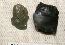 A light green, burnt and 'micro-crazed' flake from Biggar Common (left), stay unaltered, black pitchstone flake from Arran (right)