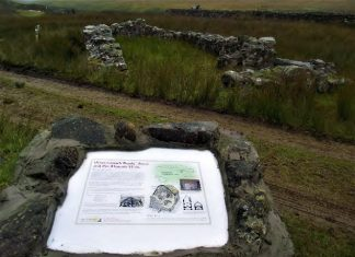 Wintercleugh Bastle Trail info panel in the landscape