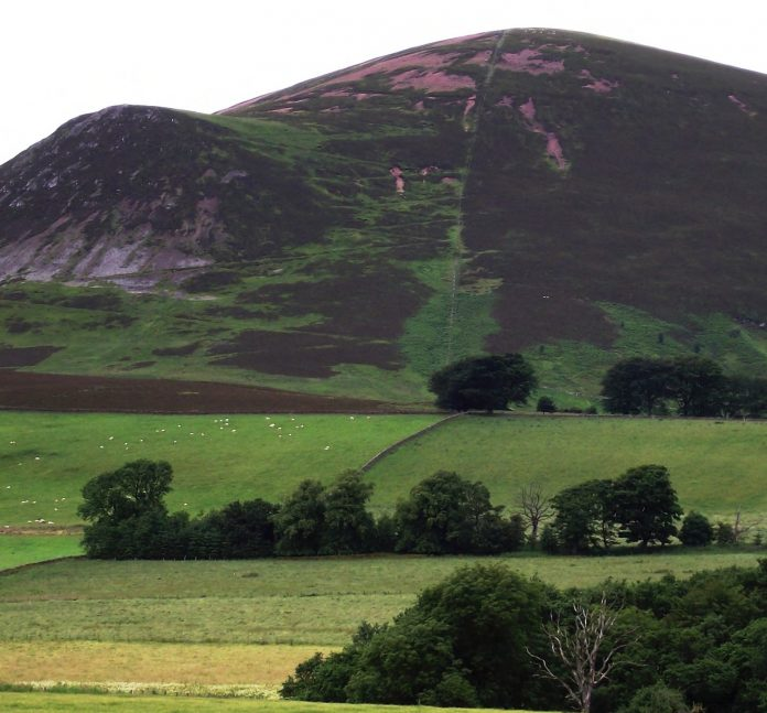 Tinto Hill as viewed from Lamington. Note the pink rock in the main body of the hill (felsite) and the black rock (basalt) protruding from a later intrusion.