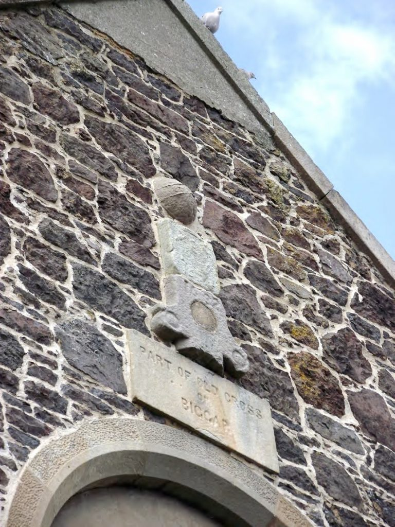Parts of the cross embedded in the south gable of the Corn Exchange. The ball finial may be the one shown in Pl 11.